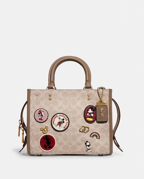 Disney X Coach Rogue 25 In Signature Canvas With Patches