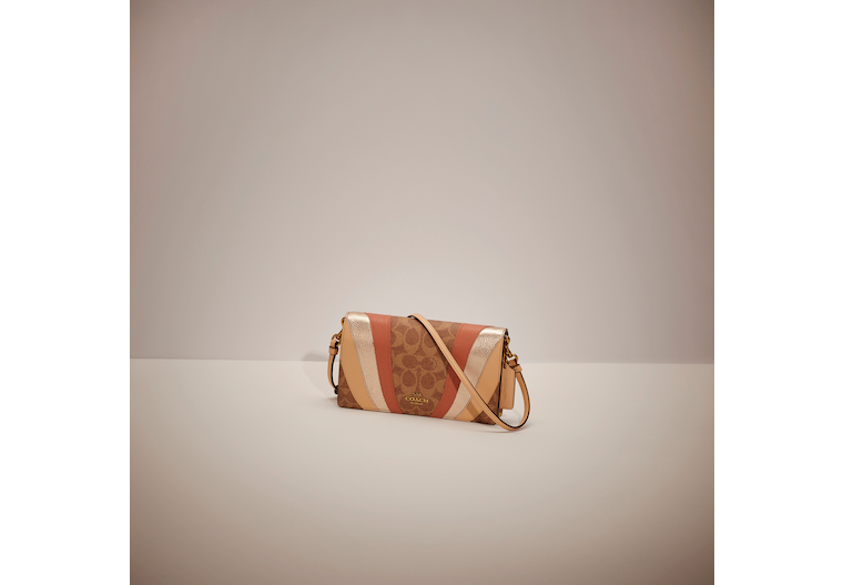Hayden Foldover Crossbody Clutch In Signature Canvas With Wave Patchwork image number 0